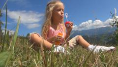 Child, Girl Playing with Soap Bubbles, Balloons on Meadow in Mountains, Children Stock Footage