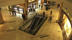 People walking in a shopping mall, holiday, Christmas time, escalators - stock footage