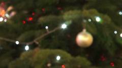 Out of focus Christmas tree, blurred lights, Christmas ball, holiday, presents Stock Footage