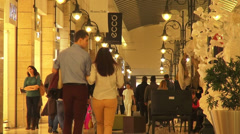 People walking in a shopping mall, holiday, Christmas time Stock Footage