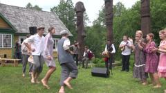 Children dancing folk dance polka invite other children dance Stock Footage