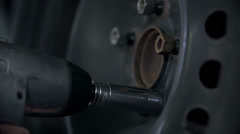 Detail of fastening the screws on a dirty tire Stock Footage
