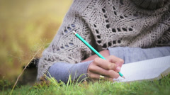 Writing in diary - stock footage