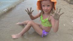 Child Splashing in Sea, Beach, Happy Girl with Dirty Sandy Hands on Seashore Stock Footage