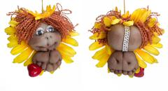 Stock Photo of both sides of doll little lion