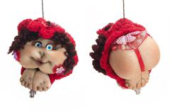 Stock Photo of both sides of doll lady in red hat