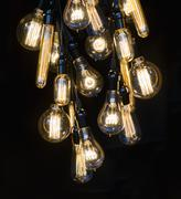 Hanging incandescent bulbs Stock Photos