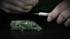 Cutting off the remaining part of a rolling paper - stock footage