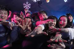 A Crowd Of Excited Young People At A Music Concert - stock photo