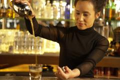 Bartender Pouring Drink Stock Photos