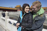 Stock Photo of Young Couple Posing For Photo At The Forbidden City