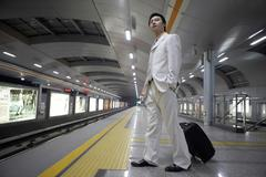 Chinese Male Waits Patiently For Subway Train To Arrive Stock Photos