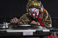 Man In Ceremonial Costume Using Turn-Tables Stock Photos