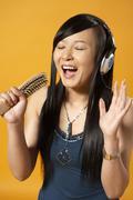 Teenager Singing Into Hairbrush - stock photo