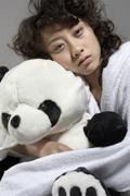 Young Woman In Bed Holding Panda Soft Toy Stock Photos