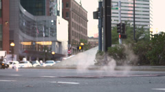 Steam coming from city street manhole slow motion Stock Footage