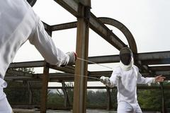 Young Men Fencing In A Construction Site Stock Photos