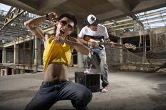 Young Men Playing Rock Music - stock photo