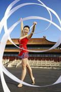 Young Woman Ribbon Dancing In Front Of A Temple Stock Photos