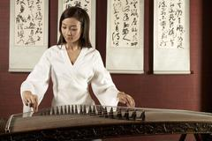 Young Woman Playing Traditional Chinese Instrument Stock Photos