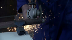 Stock Video Footage of Cutting metal with rod cutter shot in slow motion