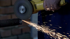 Using electric grinder in slow motion Stock Footage