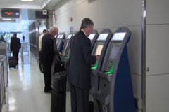 Passengers using Global Entry at Dulles International Airport Stock Footage