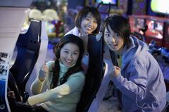 Teenagers Posing At Arcade - stock photo