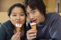 Teenage Couple Eating Icecream - stock photo