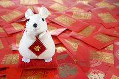 Year Of The Rat Toy With Red Packets Containing Monetary Gifts - stock photo