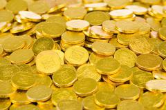 Gold Coins Symbolizing Good Luck - stock photo