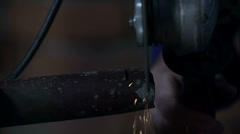 Using metal grinder to process the metal rods and tubes Stock Footage