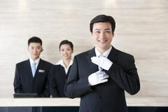 Young Employees Standing In Hotel Reception - stock photo