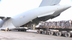 C-17A Globemaster III crew members  load pallets at Kandahar Airfield Stock Footage
