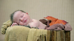 Babay resting in cosy improvised playpen Stock Footage