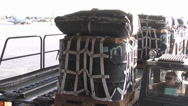Stock Video Footage of C-17A Globemaster III crew members  load pallets at Kandahar Airfield