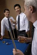 Professionals toast over billiards Stock Photos