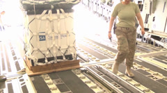 C-17A Globemaster III crew members  load pallets at Kandahar Airfield Stock Footage