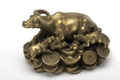 Bronzed water buffalo and calves, representing abundance and fortune Stock Photos