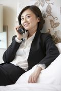 Woman in business attire talking on the telephone Stock Photos