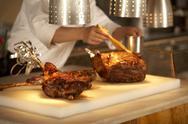 Chief cooking lamb Stock Photos