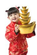 Young girl holding Chinese New Year gold ingot Stock Photos