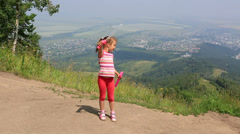 Girl blows bubbles on top of the mount tserkovka. Stock Footage