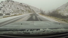 Driving mountain canyon road winter snow storm POV HD 0209 - stock footage