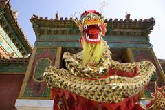 Lion dancing in front of traditional building Stock Photos