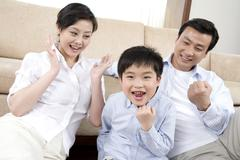 Young parents and son celebrate acheivement Stock Photos