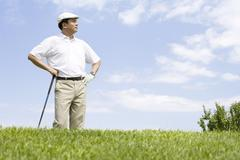 Stock Photo of Portrait of a male golfer on the course
