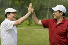 Two Golfers Celebrate a Great Shot Stock Photos
