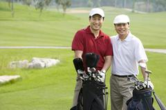 Stock Photo of Portrait of Two Golfers on the Course