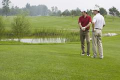 Stock Photo of Two golfers chatting on the course
